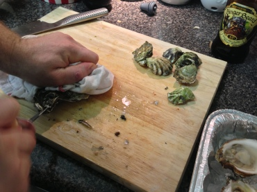 Shucking a Blue point oyster (Kumamotos on the side)